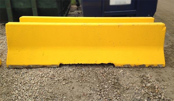 Concrete barrier painted safety yellow